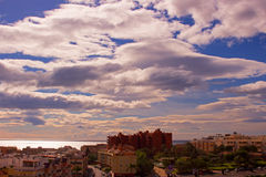 Sky, clouds, either. Estepona city, Andalusia, Spain. Sunny day at the beach Royalty Free Stock Photo