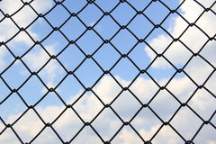 Sky and clouds through the fence Royalty Free Stock Photo