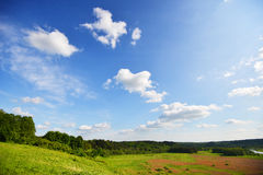 Sky , clouds and field Royalty Free Stock Photos