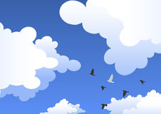 Sky with clouds and a flock of birds Stock Photo