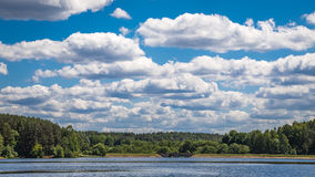 Sky clouds. Forest and lake Royalty Free Stock Photography