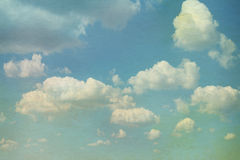 Sky with clouds in grunge style. Watercolor paper overl Stock Photo