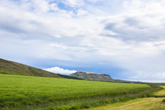 Sky with clouds and hills landscape in Iceland. Beautiful nature in summer evening in Iceland Royalty Free Stock Photos