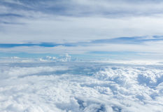 Sky and clouds looking form airplane window Royalty Free Stock Images