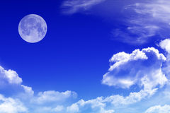 Sky with clouds and moon Stock Images
