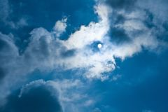 Sky, clouds and the moon - environment, nature background, weather and meteorology concept. Sky and clouds - environment, nature background, weather and royalty free stock images