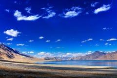 Sky, clouds and mountains,Pangong tso (Lake),Leh Ladakh,Jammu and Kashmir,India. Beautiful blue sky, clouds and mountains at Pangong tso (Lake). It is huge lake stock photography