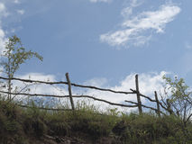 Sky, clouds and old wooden fence Royalty Free Stock Image