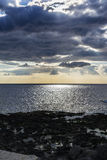 Sky with clouds over black sea at Giardini-Naxos, Sicily, Italy Royalty Free Stock Photo