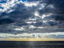 Sky with clouds over black sea Royalty Free Stock Image