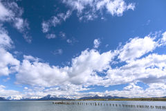 Sky with clouds over mountains and lake. Chile Stock Photo