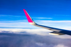Sky clouds plane wings flying sunset airplane Stock Images