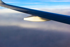 Sky clouds plane wings flying sunset travelling Royalty Free Stock Photos
