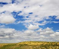 Sky with clouds after rain. In prairie Stock Image
