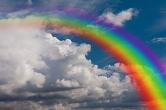 Sky, clouds and rainbow. A rainbow (arcobaleno) brings nice weather and light colors Stock Photo