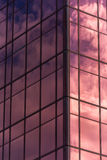 Sky and clouds reflected in windows of office building Royalty Free Stock Photography