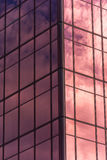 Sky and clouds reflected in windows of office building Stock Image