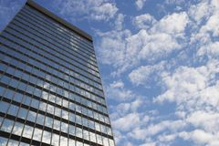 Sky and clouds reflecting in skyscraper windows low angle view Stock Photography