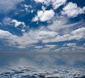 Sky with clouds and reflection. Blue sky with clouds and reflection in rendered water Stock Image