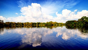 Sky and clouds reflection on Lake Stock Photo