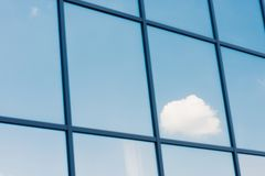 Sky and clouds reflection in the windows of modern. Office building royalty free stock image