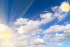 Sky with clouds and sun.  A textured background.Copy paste place. Sky with clouds and rising sun. Copy past Stock Photos