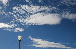 Sky clouds and searchlight Stock Images