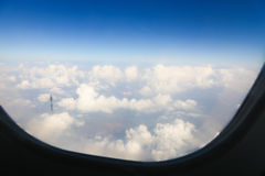 Flght window . Sky with clouds. Sky clouds,sky with clouds and sun light Royalty Free Stock Photo