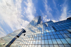 Sky and Clouds on Skyscraper Facade Stock Photography