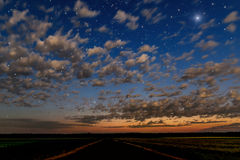 Sky clouds stars road fields Stock Photography