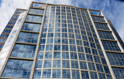 Sky and Clouds in Stone and Glass Building Stock Photography