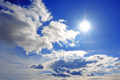 Sky clouds and the sun Royalty Free Stock Photo