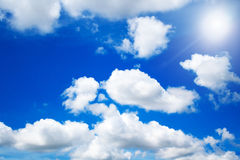 Sky clouds and sun Royalty Free Stock Image