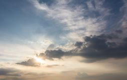 Sky with clouds and sun. Cumulus sunset clouds with sun setting down Royalty Free Stock Photo