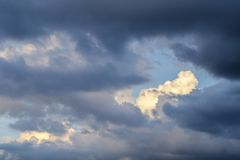 Sky with clouds and sun, Cumulus sunset clouds with sun setting Stock Photography