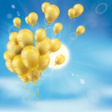 Sky Clouds Sun Golden Balloons Bunch. Bunch of golden balloons, clouds, blue sky and sun Royalty Free Stock Image