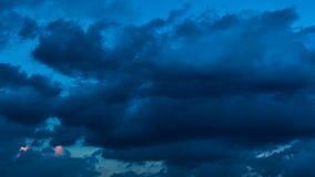 Sky and clouds at sundown. Day to night timelapse stock footage