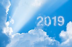 2019 among clouds and sunlight. 2019 in sky among clouds and sunlight stock photo