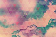 Sky with clouds and sunlight, natural background with triangles Royalty Free Stock Images