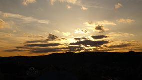 Sky with clouds at sunset. Hilly with forests, time lapse stock footage