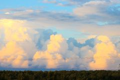 Sky with clouds at sunset. Sunset sky with multicolor clouds. Moscow Russia Royalty Free Stock Photography