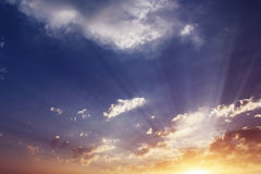Sky, clouds, sunset, the rays background Stock Photos