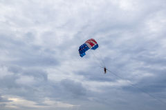 Sky and clouds Thailand. Phuket Beach. The person is engaged parasailing Stock Photography