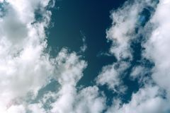 Sky between clouds weather. View royalty free stock photo