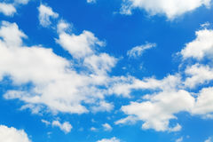 Sky and clouds. White fluffy cumuli clouds in the blue sky Royalty Free Stock Images