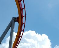 Sky Coaster. Piece of roller coaster against blue sky, white clouds stock photos