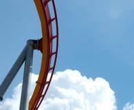Sky Coaster. Piece of roller coaster against blue sky, white clouds Stock Photos