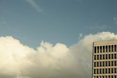 Sky on cold winter day clouds and city office block Royalty Free Stock Photography