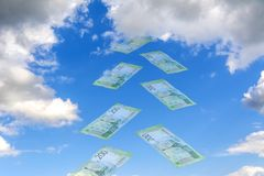 Sky Collage. Mirage - against the blue sky flying transparent Russian rubles. New banknote 200 rubles royalty free stock photo