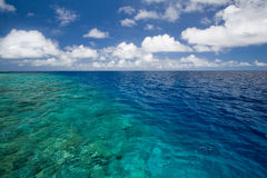 Sky and colorful ocean Stock Photos